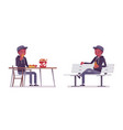 young black man sitting at table on a white bench vector image