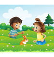 A girl and a boy with a bunny at the hill vector image