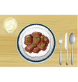 pork stew on a wooden table vector image vector image