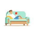 young man lying on a light blue sofa and reading a vector image vector image