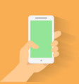 Hand holding smart phone on orange background vector image vector image