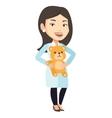 Pediatrician doctor holding teddy bear vector image vector image