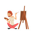 male artist drawing picture with brush on easel vector image vector image