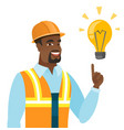 african-american builder pointing at light bulb vector image vector image