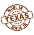 made in texas brown grunge round stamp vector image vector image