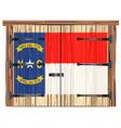 closed barn door with north carolina state flag