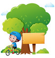 park scene with boy riding bike vector image vector image