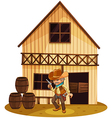 A man holding a gun in front of a wooden house vector image vector image