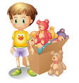 A boy beside a box of toys vector image vector image