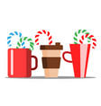 Cup of hot coffee with christmas candy sticking