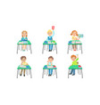 primary schools pupils sitting at desks at vector image vector image