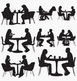 couple-sitting-in-restaurant silhouettes vector image