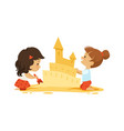 sand castle little girls play in sandbox or on vector image vector image