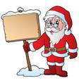 santa claus holding wooden board vector image vector image