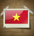 Flags Vietnam at frame on wooden texture vector image vector image