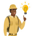 african-american traveler pointing at light bulb vector image vector image