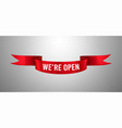 red ribbon with we re open text vector image vector image