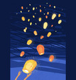 letting out chinese lanterns in night sky vector image