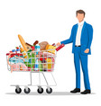 man with shopping cart full fresh products vector image