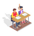 two students boy and girl sit at desk with books vector image vector image