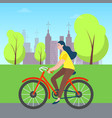 woman riding on bicycle in green city park trees vector image vector image