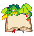 green dragon holding old book vector image