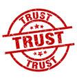 Trust round red grunge stamp vector image