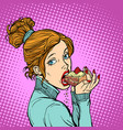 woman eating a piece of cake vector image