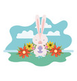 easter bunny with landscape isolated icon vector image