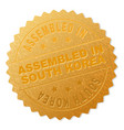 golden assembled in south korea award stamp vector image vector image