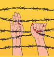 pop art female hands holding a barbed wire vector image