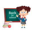 back to school cute girl standing near blackboard vector image vector image