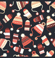 seamless background with hats and mittens vector image