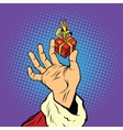 Hand of Santa Claus and a small gift vector image vector image