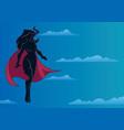 superheroine flying in sky silhouette