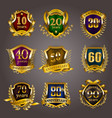 set of gold anniversary badges vector image vector image
