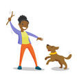 african-american woman training dog with stick vector image vector image