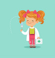 cute red-haired baby girl standing with medical vector image