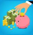 hand putting bitcoin dollar into saving piggy bank vector image