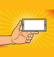 thumb up holding a smartphone with empty screen vector image