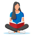 young woman sitting cross-legged and read book