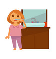 little redhead girl brushes her teeth near vector image vector image