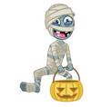cartoon mummy character hold halloween pumpkin vector image vector image
