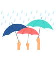 hands holding umbrellas vector image