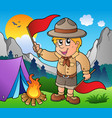 scout boy with flags outdoor vector image