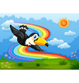 A bird in the sky with a rainbow vector image vector image