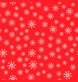 Seamless pattern white snowflakes on a red