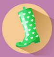 green classic gumboot with white hearts pattern vector image