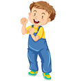 Little boy in jumpsuit smiling vector image vector image