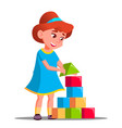 little girl playing in building blocks vector image
